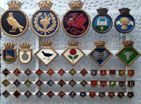 Ship badges from the National Maritime Museum. The top row shows HMS Benbow, HMS Renown, HMS Marlborough, HMS Kenilworth Castle and HMS Loch More