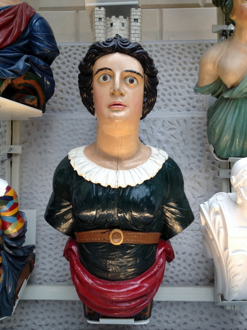 The figurehead for HSM London (1840-84) has a model of the Tower of London on her head.